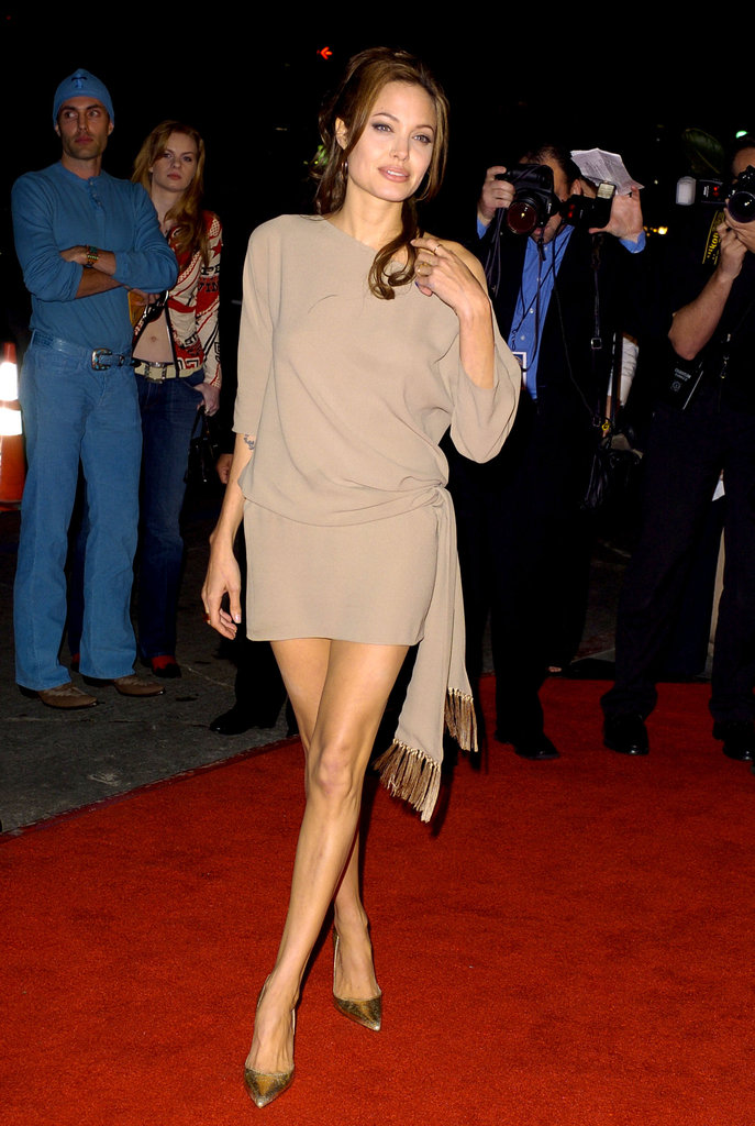 Angelina Jolie stepped out in a short mini dress for the March 2004 LA premiere of Taking Lives.
