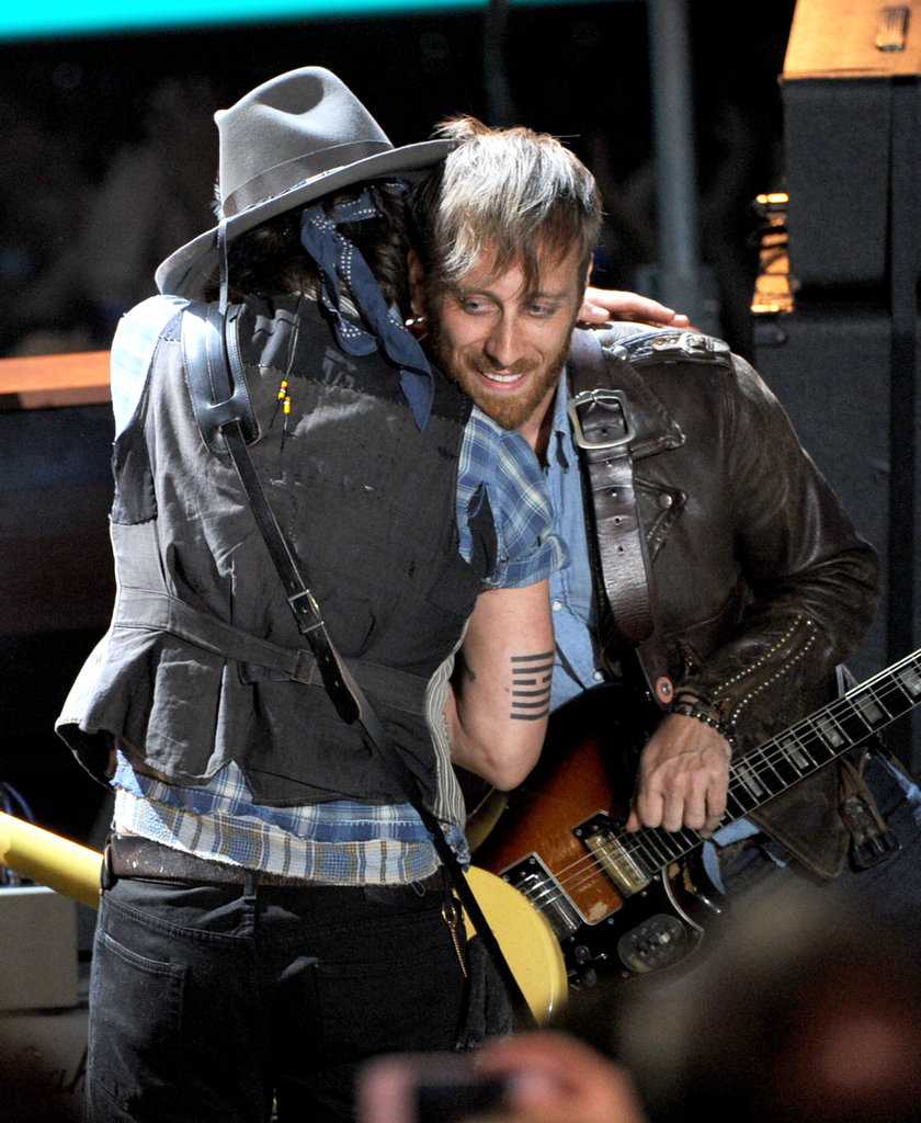 Johnny Depp hugged Dan Auerbach.