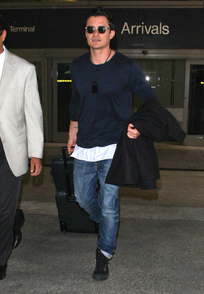 Orlando Bloom carried his jacket.