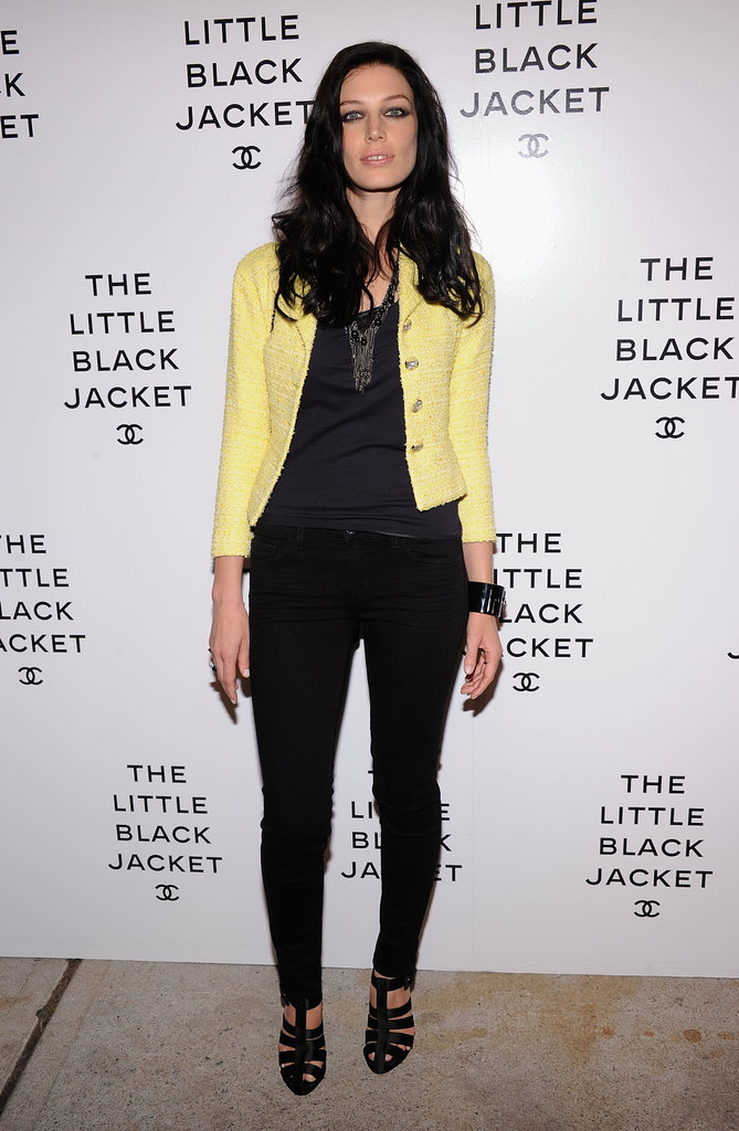 Mad Men's Jessica Paré chose a little yellow Chanel jacket and statement necklace to dress up skinny black pants and a basic tank.