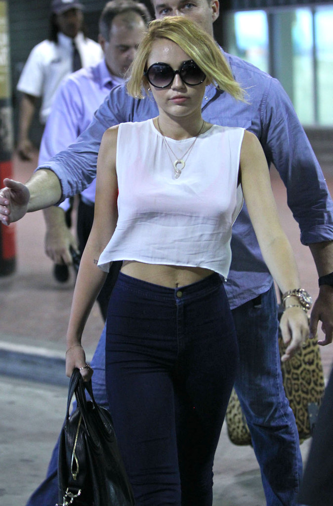 Miley Cyrus stayed cool in a cutoff tank top in New Orleans.
