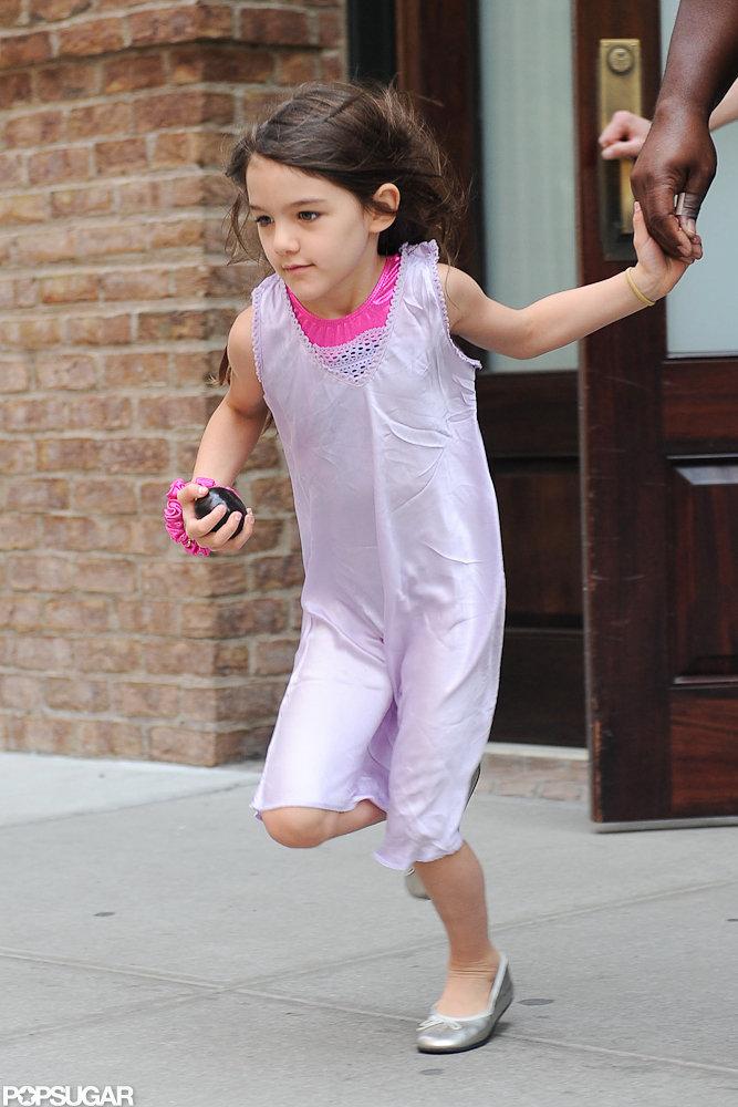 Suri Cruise looked cute in a purple dress.