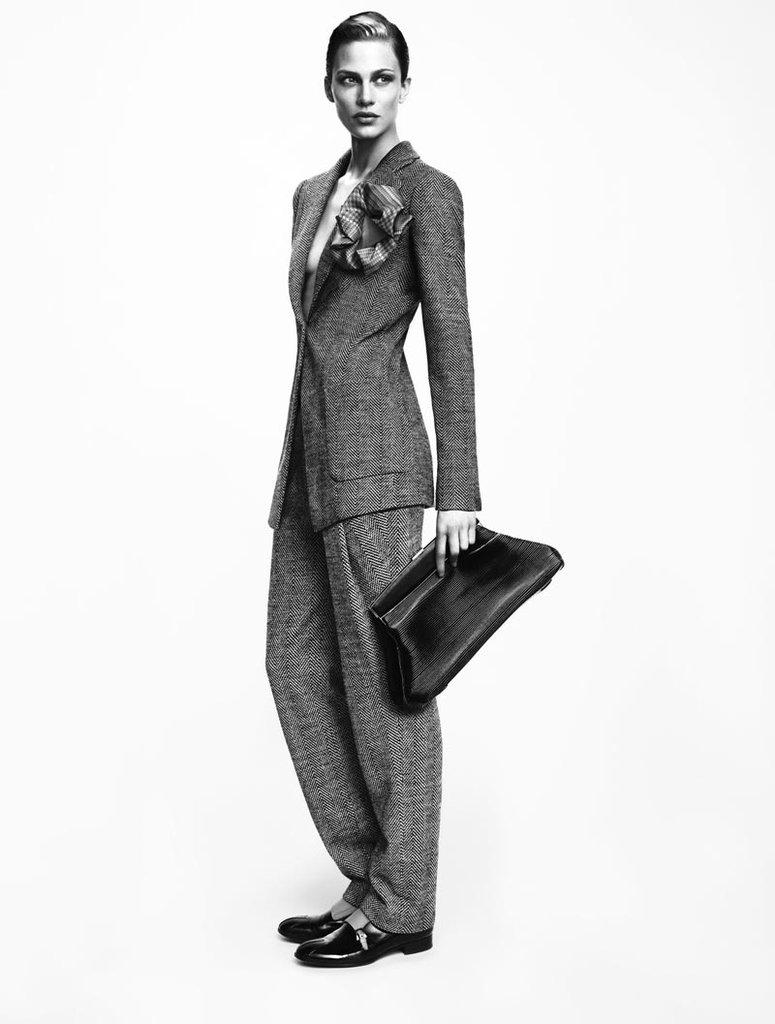 Giorgio Armani's Fall '12 ads capture the essence of menswear-inspired elegance.