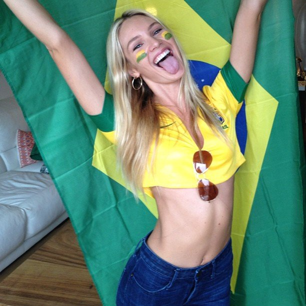 Candice Swanepoel got into the Brazilian spirit watching a game. Source: Instagram user angelcandices