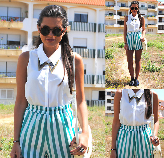Candy-striped shorts add playfulness to a white button-up.  Photo courtesy of Lookbook.nu