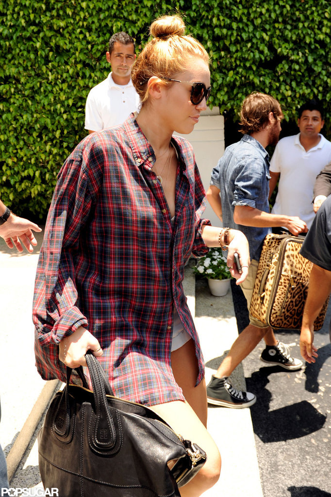Miley Cyrus got into the car leaving her Miami hotel.