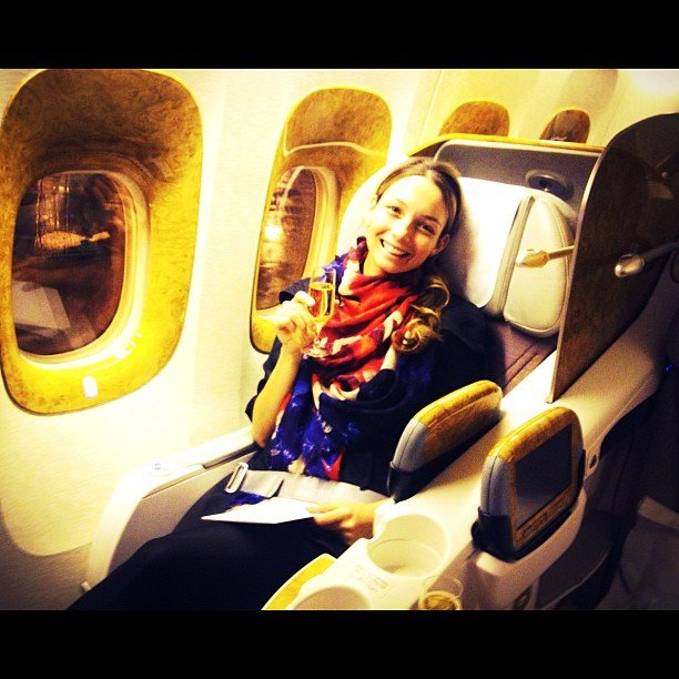 Ricki-Lee Coulter enjoyed a champagne on her early morning flight. Source: Instagram user therickilee