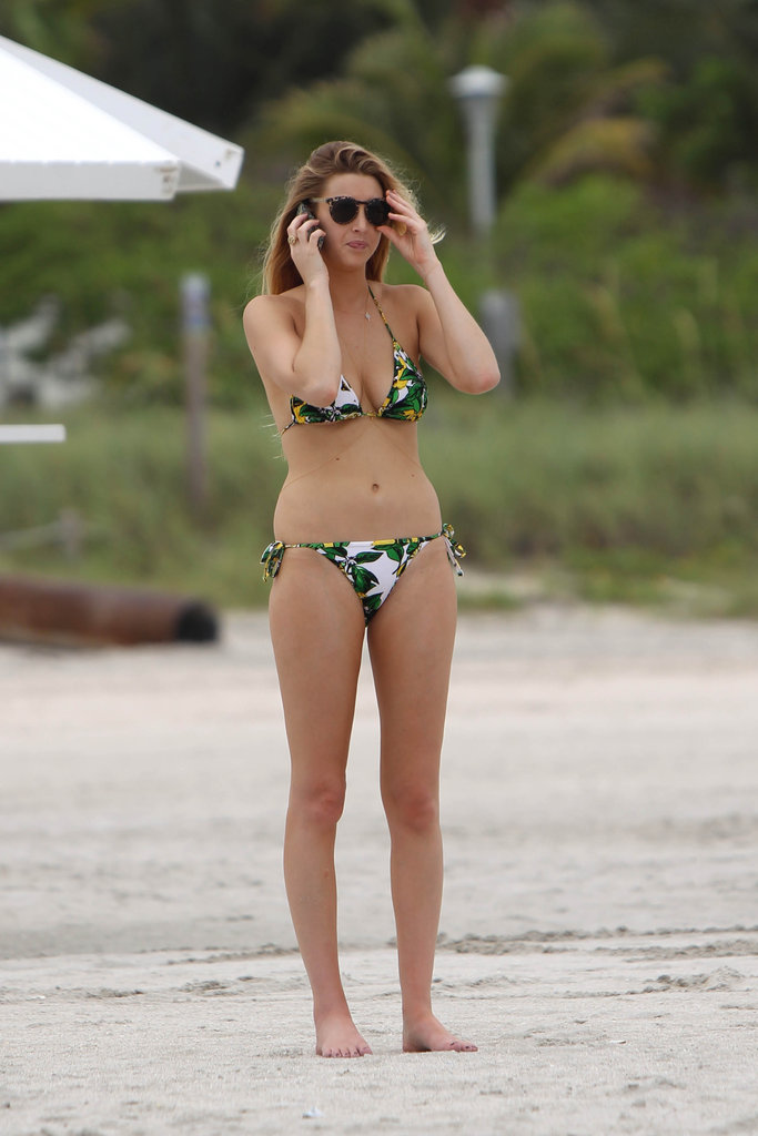 Whitney Port talks on the phone at the beach.