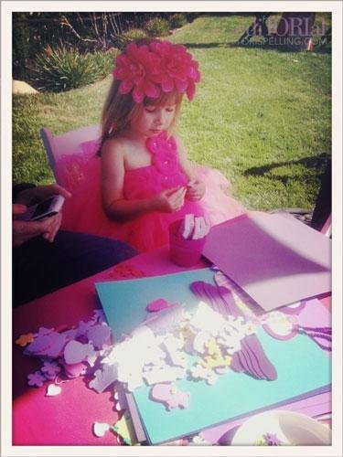 This makes a Craftista mom so happy! A chip off the old block. She loves to craft! Here she is making foam crowns with embellishments from Oriental Trading Company.