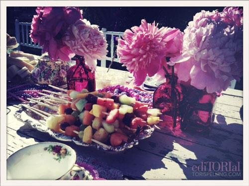 Simple wood skewers of fruit acted as magic fairy fruit wands and took on a whole new look when placed on silver serving trays found at a yard sale and lovingly polished.