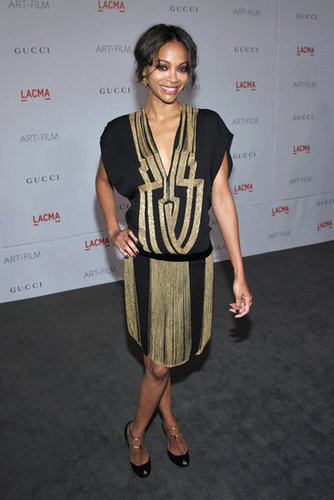 Channeling a chic version of flapper style, Zoe wore a black and gold Gucci drop-waist dress with Gucci T-strap heels to a LACMA Art + Film gala in November 2011.