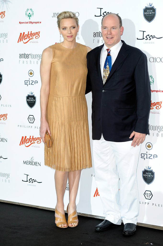 Charlene attended a fashion show and charity auction in Monaco with Prince Albert and brought out her easy-chic fashion sense in a sophisticated but not overworked sheath dress and sandals.