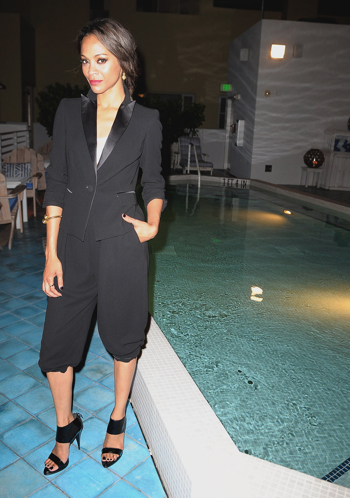 The actress posed poolside at the Colombiana afterparty in Miami, donning a cropped tuxedo blazer and cropped trouser look.