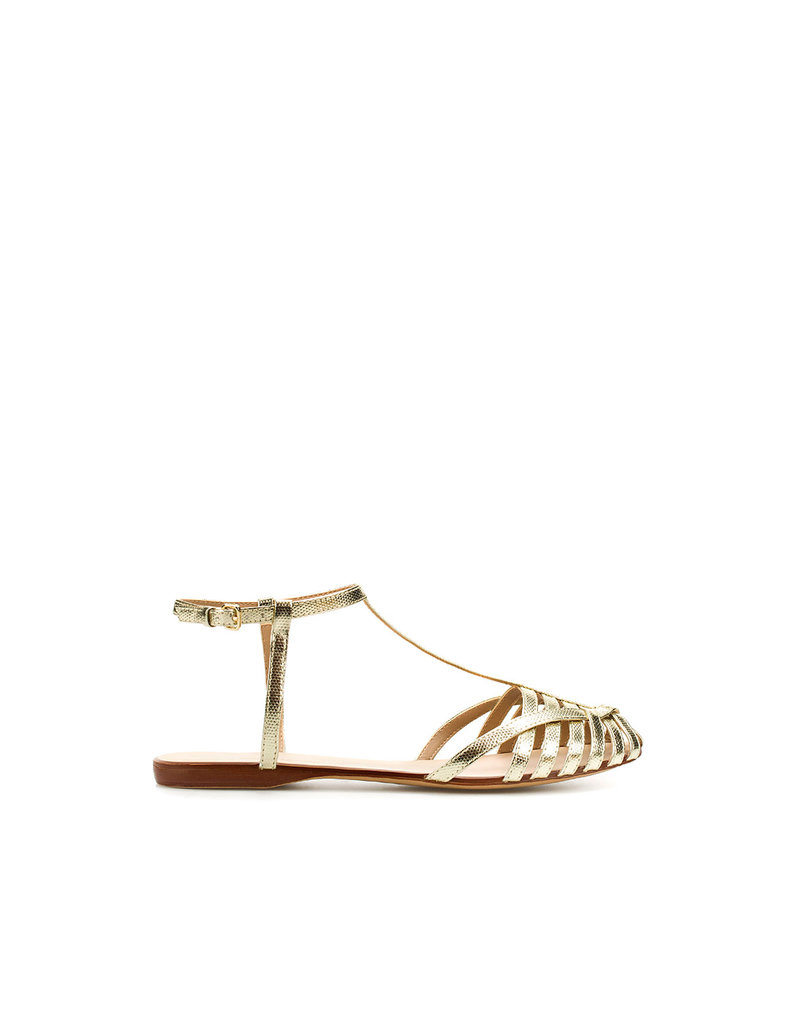 These gilded sandals put a sophisticated spin on the jellies we loved growing up.  Zara Plaited Jelly Shoe ($50)