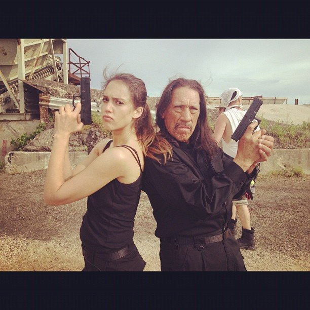 Jessica Alba played with guns with her Machete Kills co-star Danny Trejo.  Source: Instagram user jessicaalba