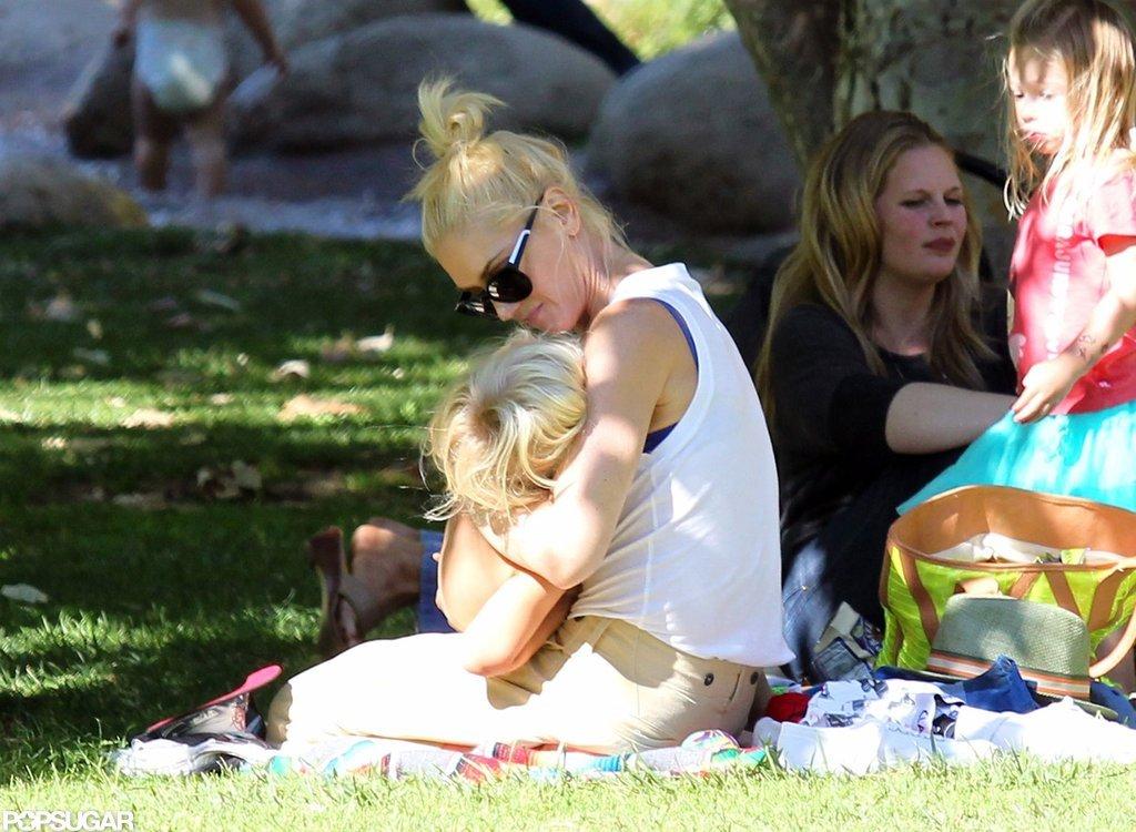 Gwen Stefani held her little one in an LA park.