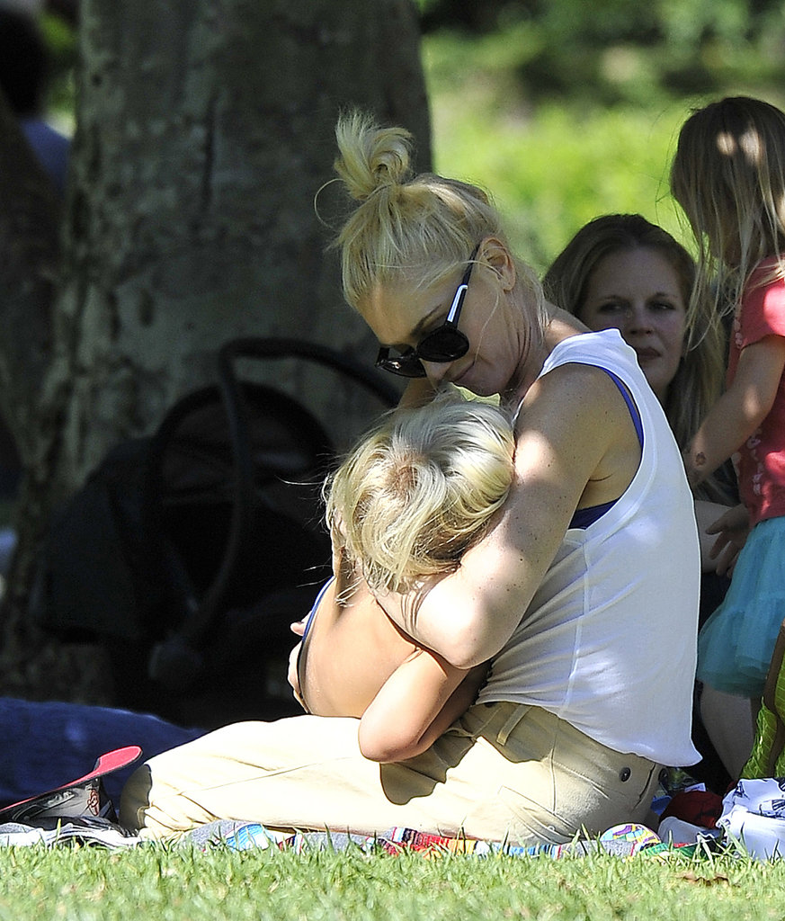 Gwen Stefani gave her little one a hug while the two sat together in the shade.
