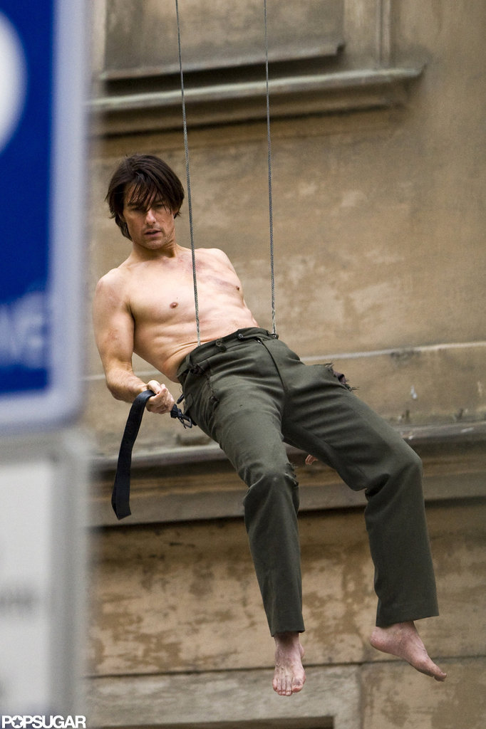 Tom Cruise was shirtless, dangling from a building for the filming of Mission: Impossible — Ghost Protocol  in October 2010.