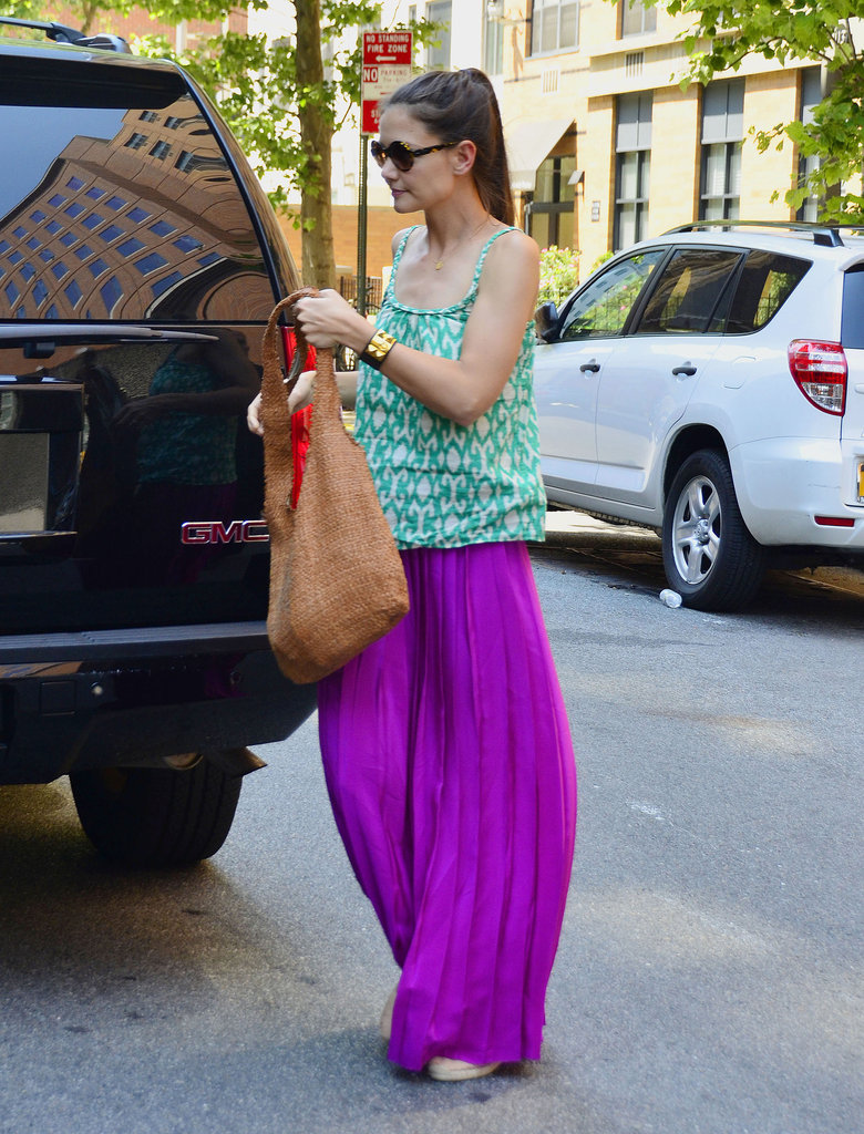 Katie Holmes toted her dark brown woven shoulder bag with a vivid violet maxi skirt and an ikat-print Gap tee.