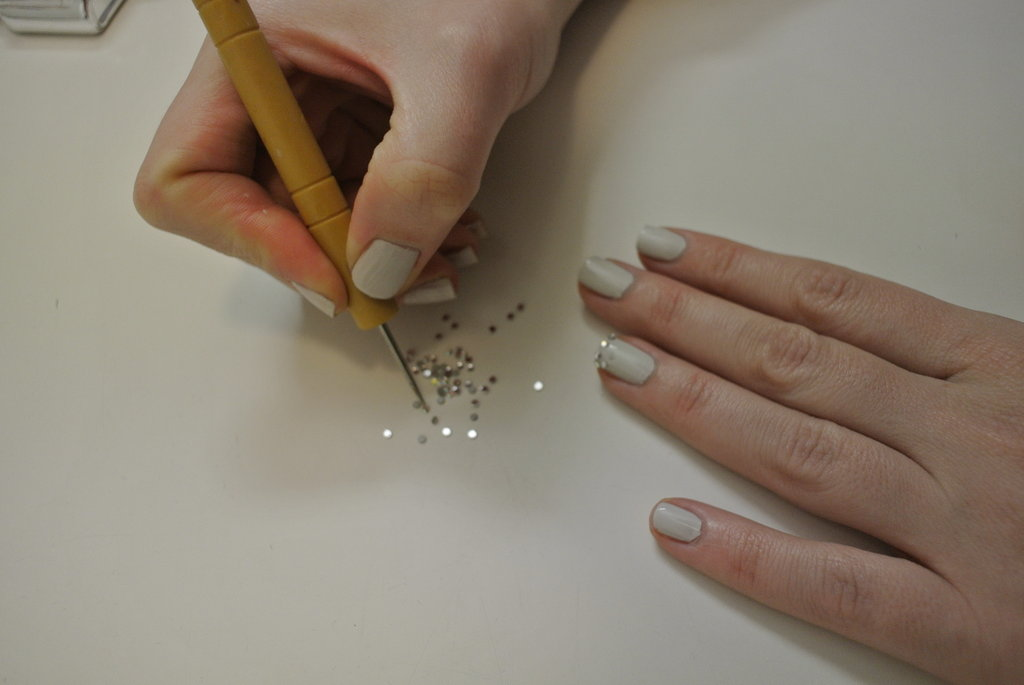 Remember, it's the top side you want to pick up, not the flat base. This way, you can basically drop it onto your nail.