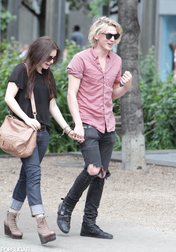 Lily Collins held hands with her new man.