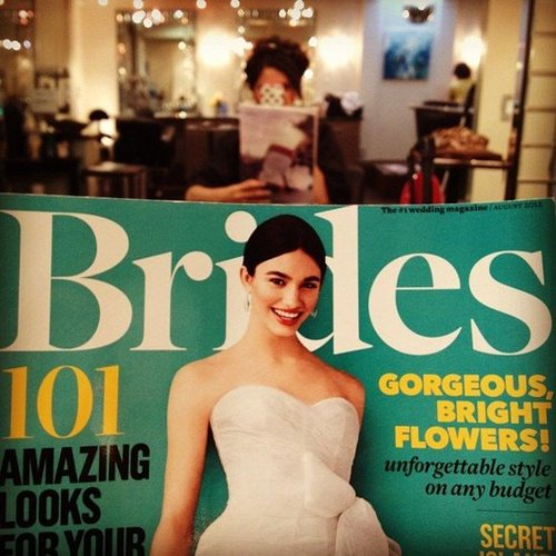 "Bride-to-be karlibulnes is a multitasking reader. She writes, ""Reading bridal mags while I still can and getting my hair did."""
