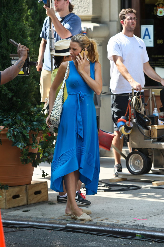 Blake Lively held a phone to her ear on the set of Gossip Girl in NYC.