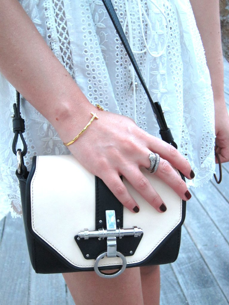 We love how she contrasted her girlie romper with sharp accessories.