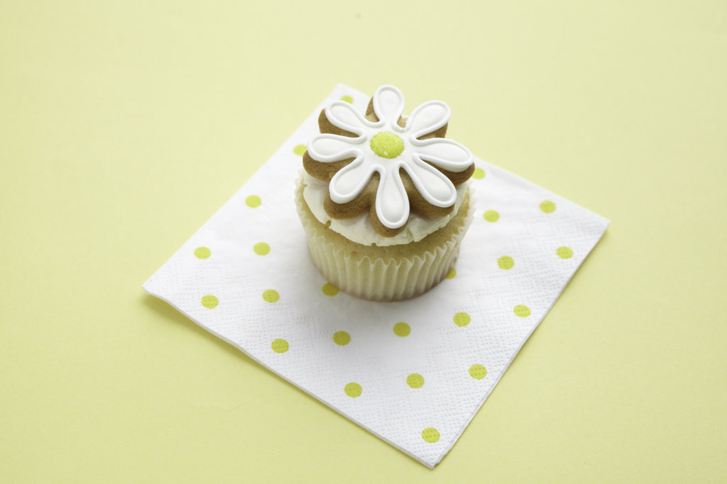 Cookies are great on their own, but they make perfect cupcake toppers, too. These daisy sugar cookies from Eleni's (which happens to be a nut-free bakery) will be available through the sale, too.  Source: Photos by Bryan Gardner. Courtesy of Martha Stewart