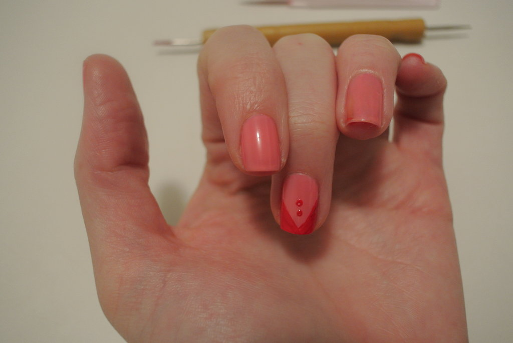 Very carefully (had a case of the shaky hands here!), I pressed the stylus onto my nail to create two buttons. I made sure my nail was sitting straight on the table for this, as they need to sit directly in line.