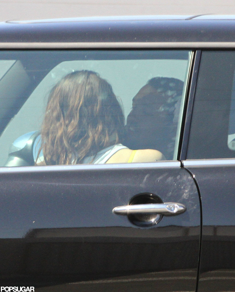 Rupert Sanders and Kristen Stewart cuddled up in her car.