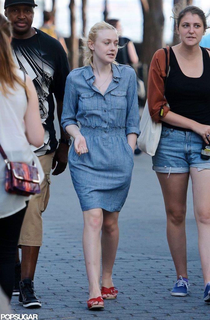Dakota Fanning wore a denim dress on the set of Very Good Girls in NYC.
