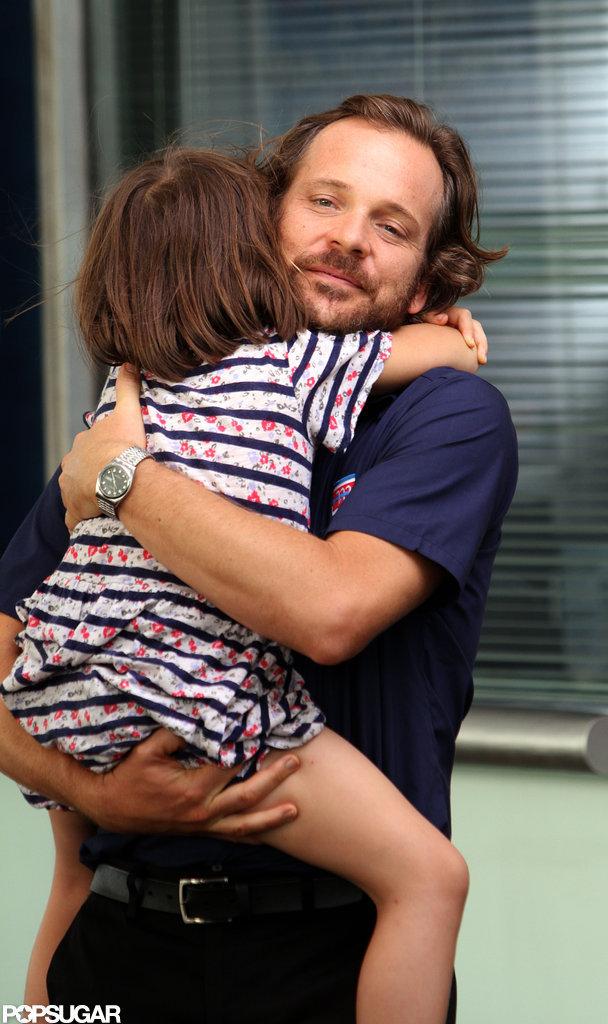 Peter Sarsgaard squeezed daughter Ramona tight.