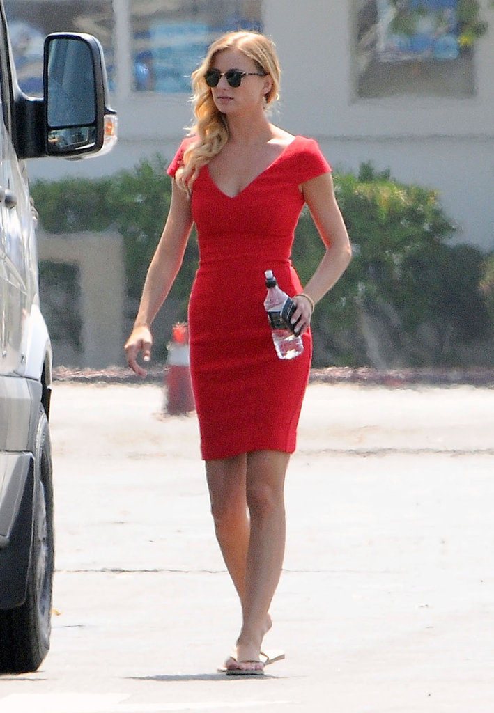 Emily VanCamp sported a red dress and sunglasses.