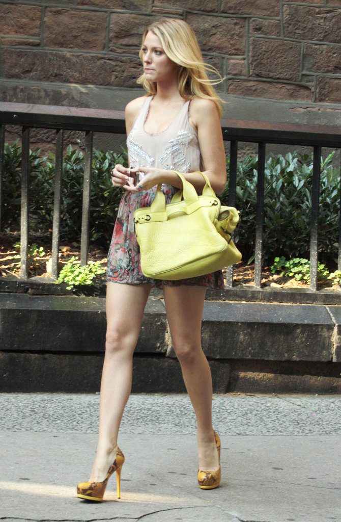 Even in daytime mode, Serena van der Woodsen rocks a fierce pair of pumps and bright scene-stealing wares. Case in point: it's all about neon pops (hello 3.1 Phillip Lim satchel!), bold exotics (thanks Pour La Victoire heels), and pretty florals (the Haute Hippie skirt is perfection).