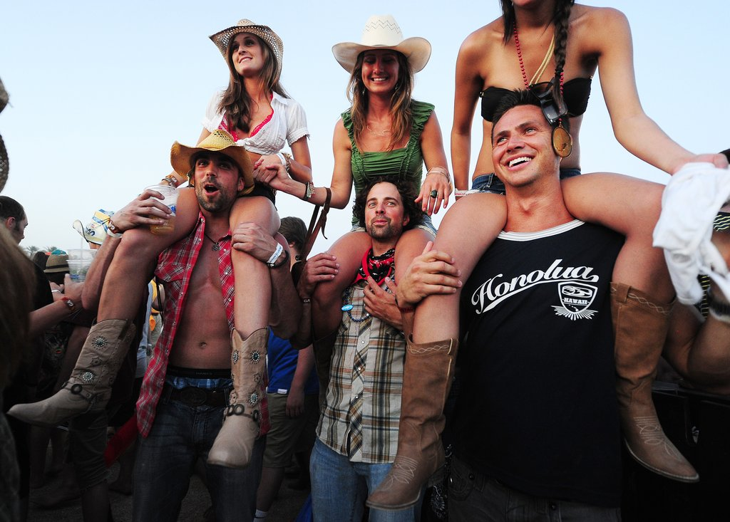 Three boyfriends gave their significant others a boost at Stagecoach in Indio, CA.