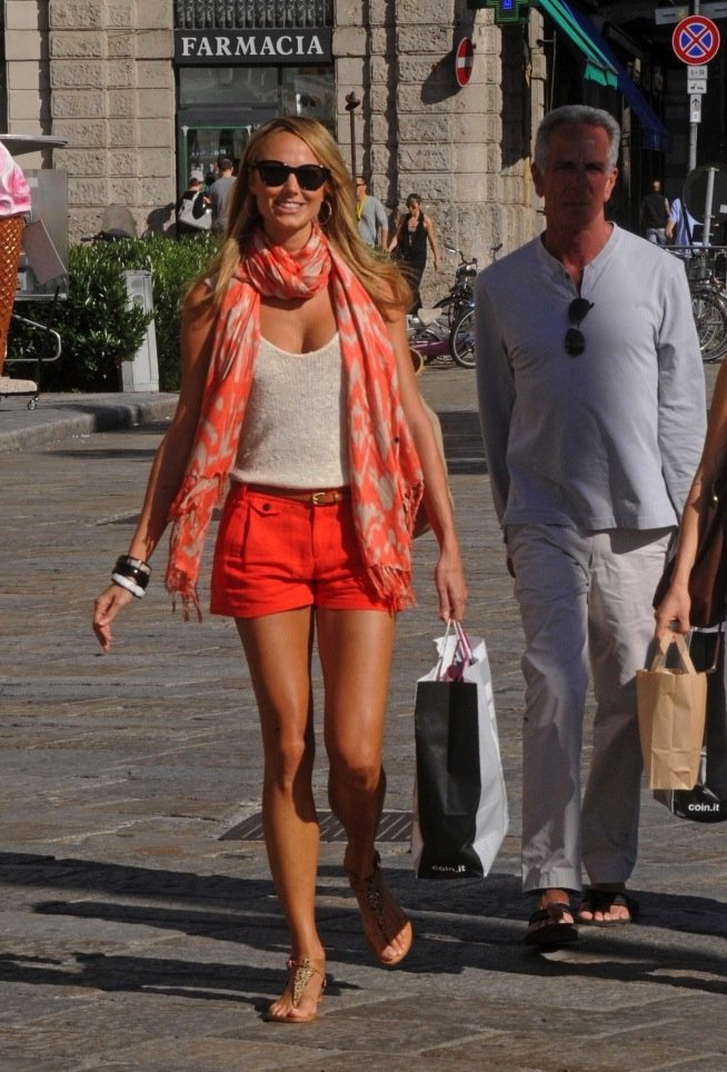 Put a sophisticated spin on your shorts-and-tank combo with a soft feminine scarf — the more luxurious the fabric, the more polished the finish. Need inspiration? Stacy Keibler chose a Sir Alistair Rai scarf ($89) to offset her bold orange Rag & Bone shorts ($154).