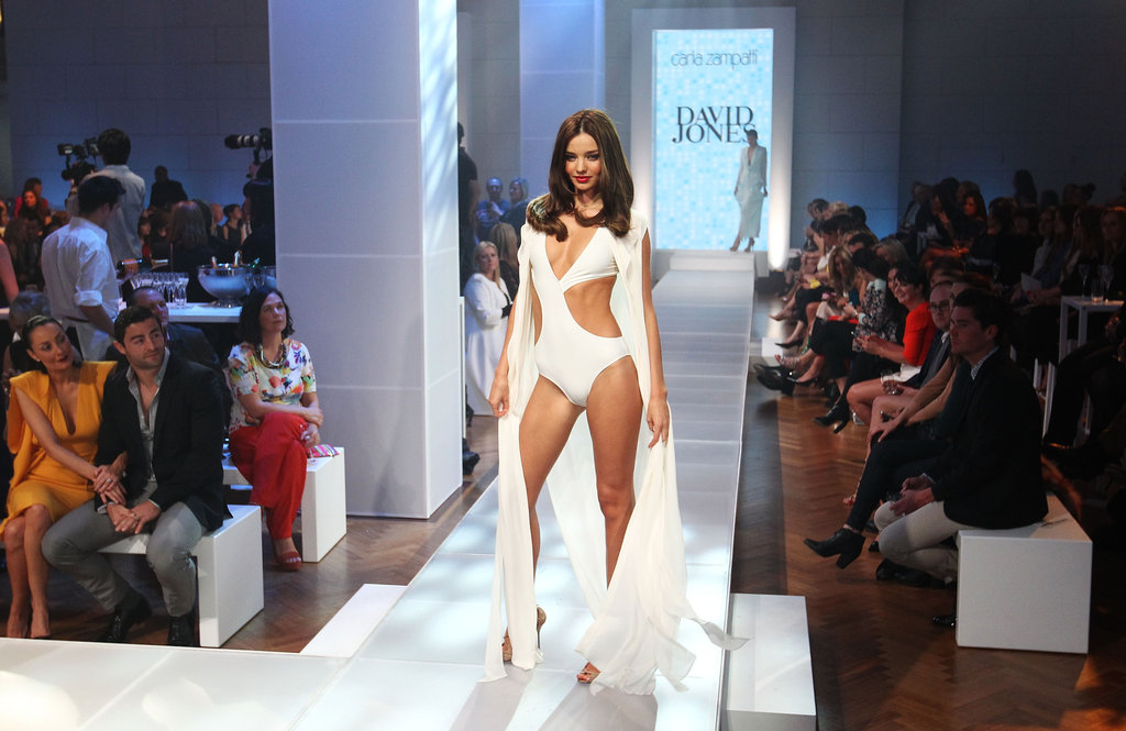 Miranda Kerr modeled a white swimsuit and floor-length shawl at the David Jones Season Launch.