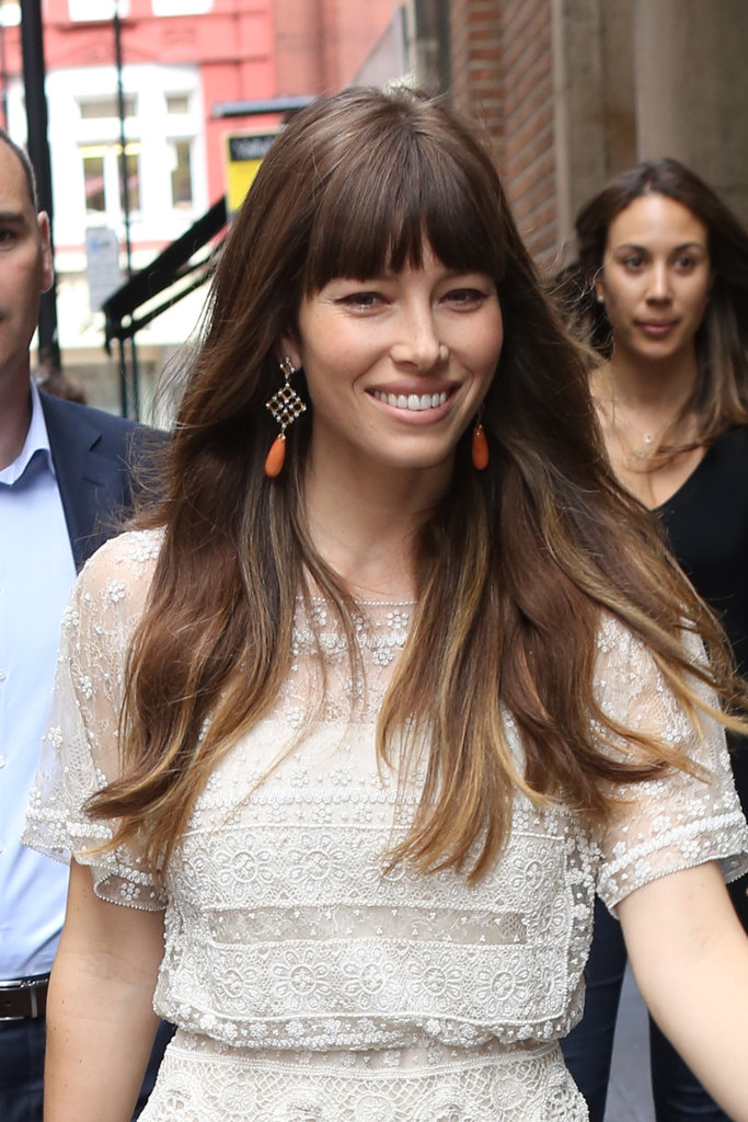 She chose a boho-chic pair of orange drop earrings to complement her ultrafeminine lace Valentino jumpsuit.