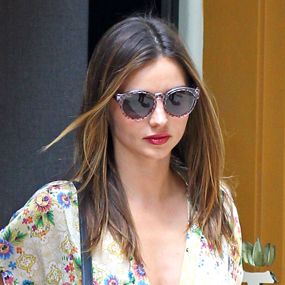 This time with cool shades, Miranda had red lips for an appointment in July.