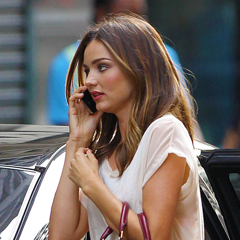 Miranda's red-orange lips looked amazing with her highlights in July.