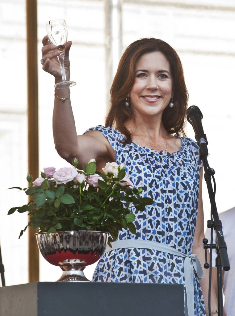 Crown Princess Mary of Denmark toasted the crowd at the opening of the Odense Flower Festival in Denmark on August 15.