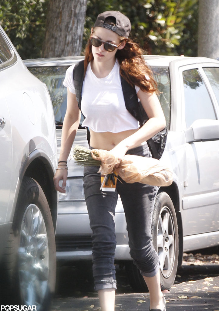Kristen Stewart wore a cropped shirt and jeans.