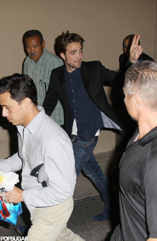 Robert Pattinson waved to fans in LA.