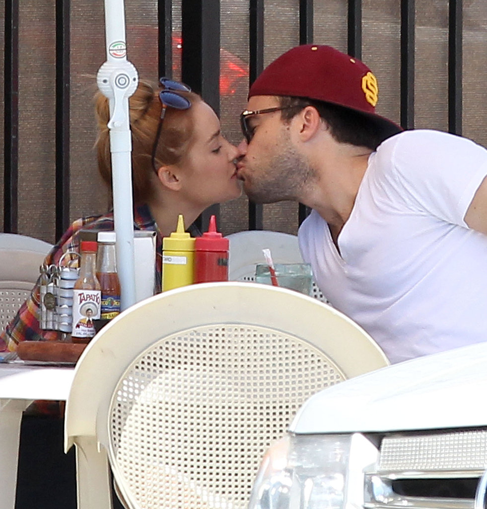Lauren Conrad and boyfriend William Tell enjoyed a kiss at Nick's Coffee Shop in LA in June 2012.