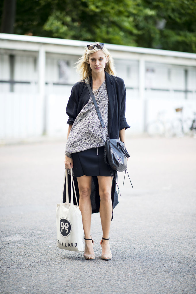 The coolest kind of laid-back layers make for a no-fuss transitional look — add in heels, and you've got the sexier version, like this street-style star. Source: Adam Katz Sinding