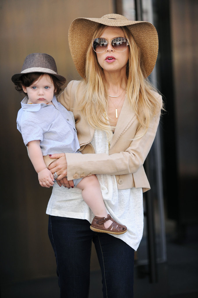 In June, Rachel Zoe toted her son, Skyler, around NYC. He wore a fedora, a crisp blue oxford shirt, and brown sandals — ideal for hot Summer days.