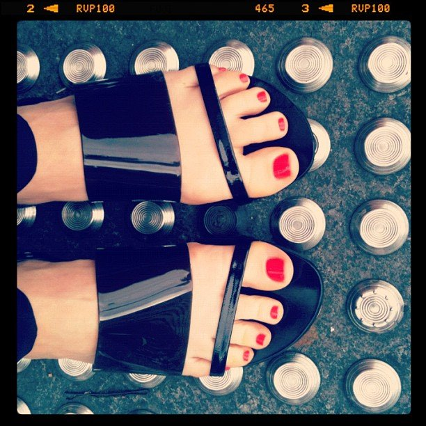 Ali showed off her brand spankin' new Country Road sandals and pedicured toes. She's wearing Hello Darling in Hot Tamale.
