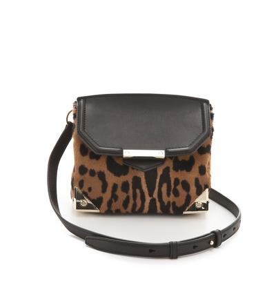 """Couple standout leopard print with Wang's ultrasleek silhouette and metallic hardware, and I'm gushing over this little crossbody bag that I already imagine styling out with my go-to army jacket and staying fashionably (and functionally) hands-free all season. For a chic evening twist, I'll tuck in the strap and carry it as the cool-girl kind of clutch that lends the perfect finish to an LBD — and red lipstick."" — Hannah Weil, associate editor Alexander Wang Marion Haircalf Bag ($745)"