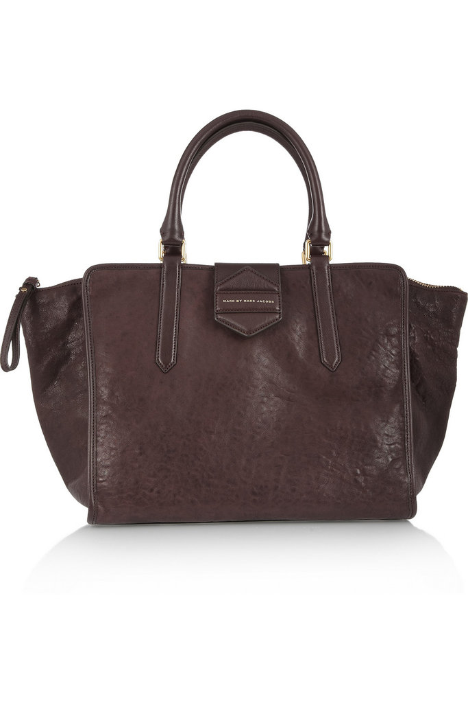 """I don't usually go for bigger tote silhouettes, but I couldn't resist this perfectly distressed leather texture in the richest Fall shade of brown. Plus, it will definitely hold my scarf, gloves, and hat without making me look like I do, in fact, carry my whole life around with me."" — Marisa Tom, associate editor Marc by Marc Jacobs Flipping Out Textured-Leather Tote ($600)"